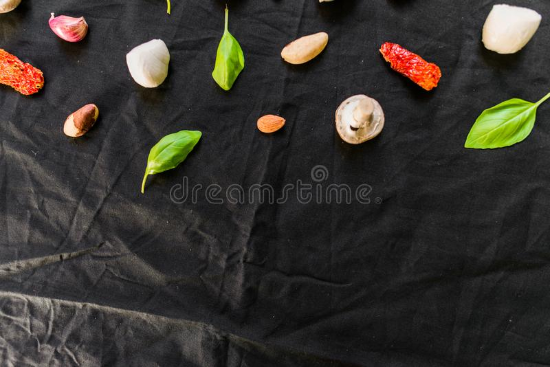 Selection of different Italian food ingredients against black background. Selection of different Italian food ingredients royalty free stock images