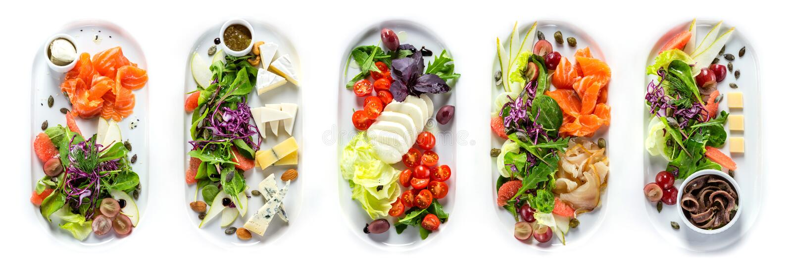 Selection of different kinds of cheese and fish stock photos