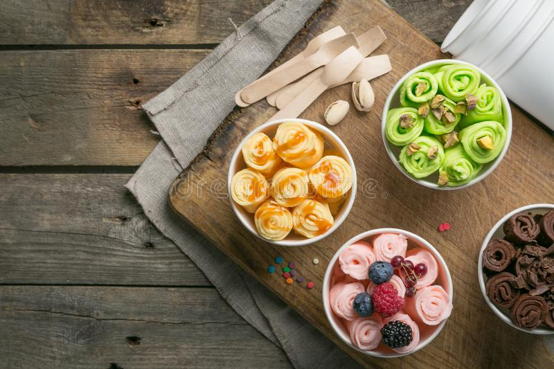 Selection of different rolled ice creams in cone cups stock photo
