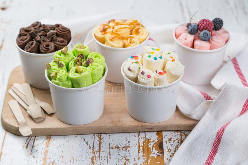Selection of different rolled ice creams in cone cups royalty free stock image