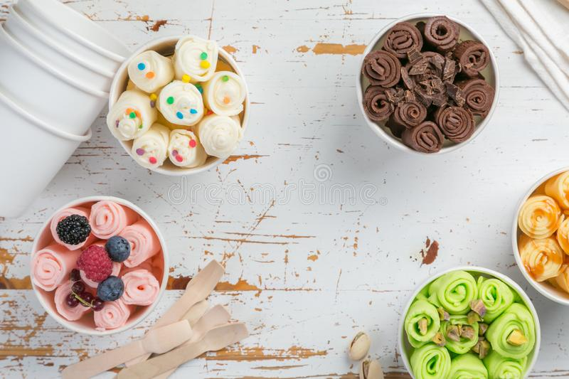 Selection of different rolled ice creams in cone cups stock photography