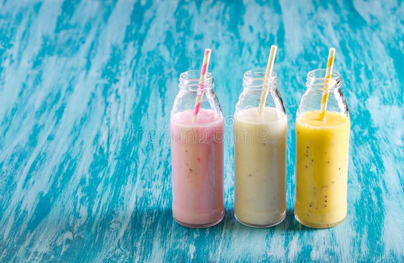 Selection of different smoothie in bottles royalty free stock photo