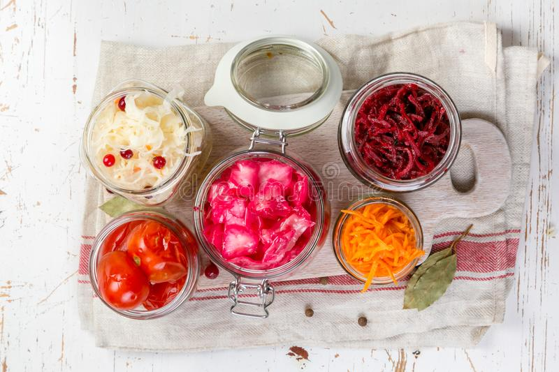 Selection of fermented food - carrot, cabbage, tomatoes, beetroot, copy space. Wood background royalty free stock photography
