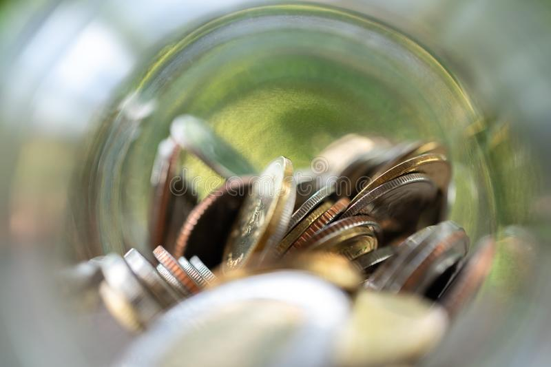 Selection focus. Saving money concept of collecting coins Thai money in a glass bottle. s background business concept and Saving royalty free stock image