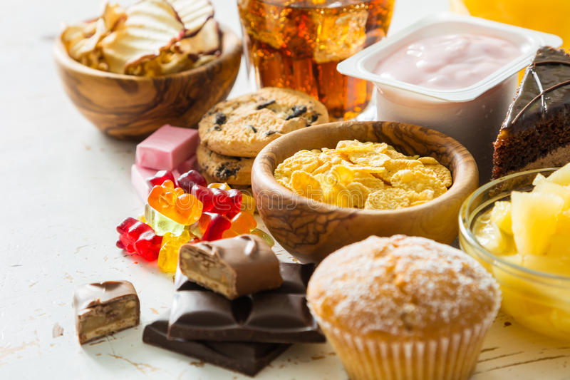 Selection of food high in sugar. Copy space stock images