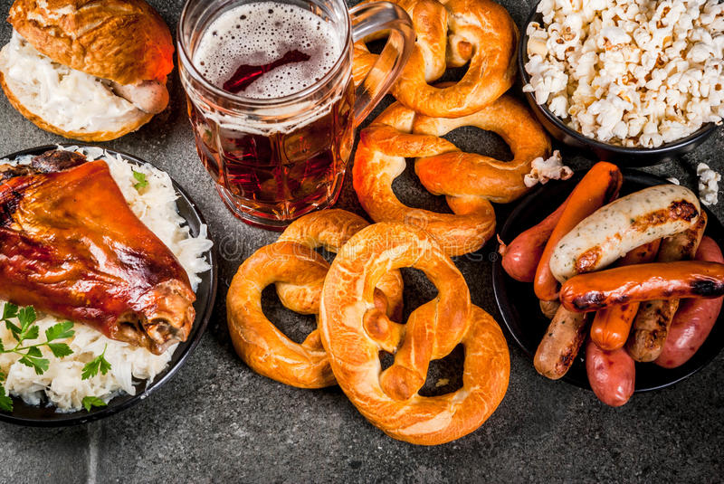 Selection food for Oktoberfest. Selection of traditional German food Oktoberfest. Beer, baked pork shank, popcorn, assortment of different sausages, homemade stock photography