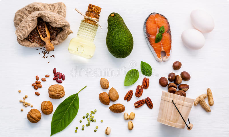 Selection food sources of omega 3 . Super food high omega 3 and. Unsaturated fats for healthy food. Almond ,pecan ,hazelnuts,walnuts ,olive oils ,fish oils royalty free stock photography