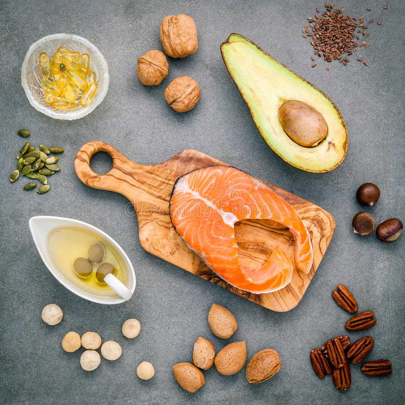 Selection food sources of omega 3 and unsaturated fats. Super food high omega 3 and unsaturated fats for healthy food. Almond stock photo