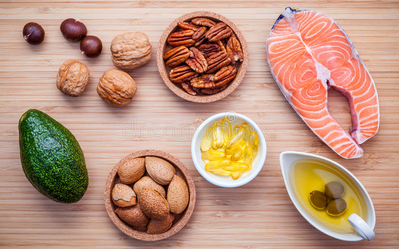 Selection food sources of omega 3 and unsaturated fats. Super food high vitamin e and dietary fiber for healthy food. Almond. Pecan ,hazelnuts,walnuts ,olive royalty free stock images