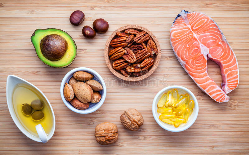 Selection food sources of omega 3 and unsaturated fats. Super food high vitamin e and dietary fiber for healthy food. Almond. Pecan ,hazelnuts,walnuts ,olive royalty free stock photos