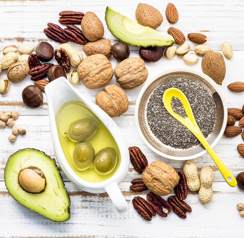 Selection food sources of omega 3 and unsaturated fats. Super foods high vitamin e and dietary fiber for healthy food on wooden. Background royalty free stock images