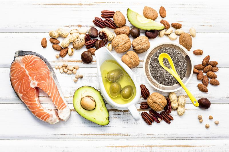 Selection food sources of omega 3 and unsaturated fats. Super foods high vitamin e and dietary fiber for healthy food on wooden. Background royalty free stock image