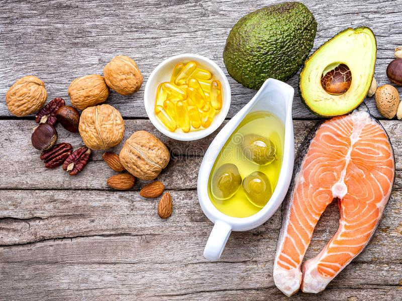 Selection food sources of omega 3 and unsaturated fats. Super foods high vitamin e and dietary fiber for healthy food on wooden. Background royalty free stock photo