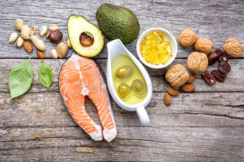 Selection food sources of omega 3 and unsaturated fats. Super foods high vitamin e and dietary fiber for healthy food on wooden. Background royalty free stock photography