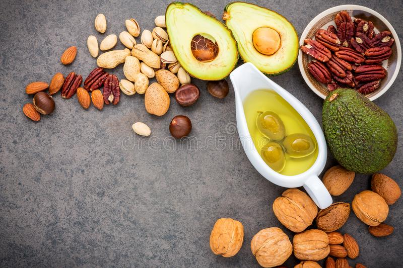 Selection food sources of omega 3 and unsaturated fats. Superfood high vitamin e and dietary fiber for healthy food. Almond. Pecan,hazelnuts,walnuts,olive oil royalty free stock photos