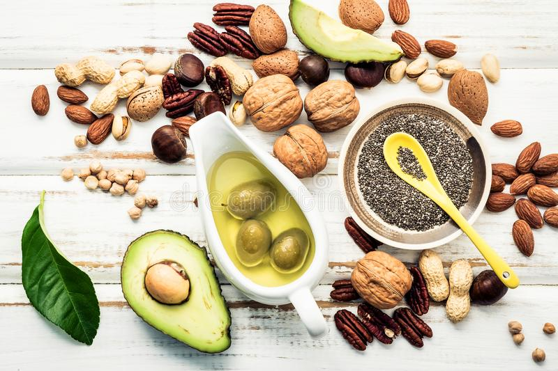Selection food sources of omega 3 and unsaturated fats. Superfood high vitamin e and dietary fiber for healthy food. Almond. Pecan,hazelnuts,walnuts and olive stock photography