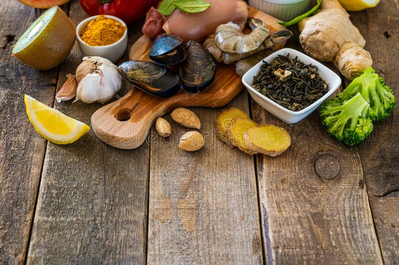 Selection of food to boost immune system - healthy, rich in vitamin and antioxidants. Copy space royalty free stock photos