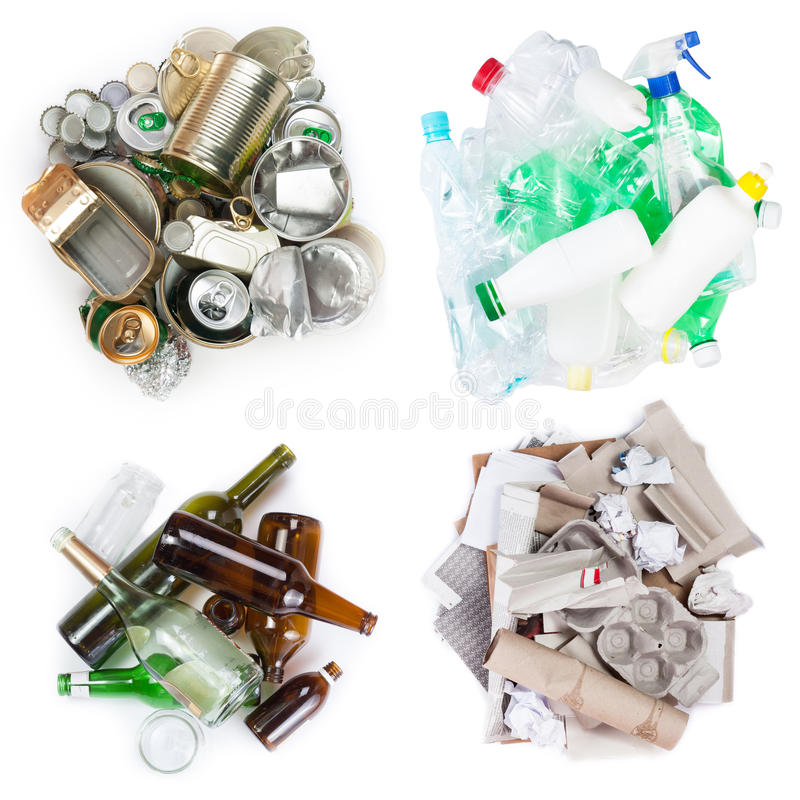 Selection of garbage. A selection of garbage for recycling. Segregated metal, plastic, paper and glass on white background royalty free stock photos
