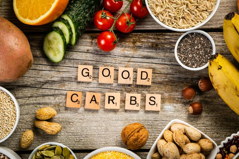 Selection of good carbohydrates sources. Healthy vegan diet. Selection of good carbohydrates sources - vegetables, fruits, grains, legumes, nuts and seeds stock photo