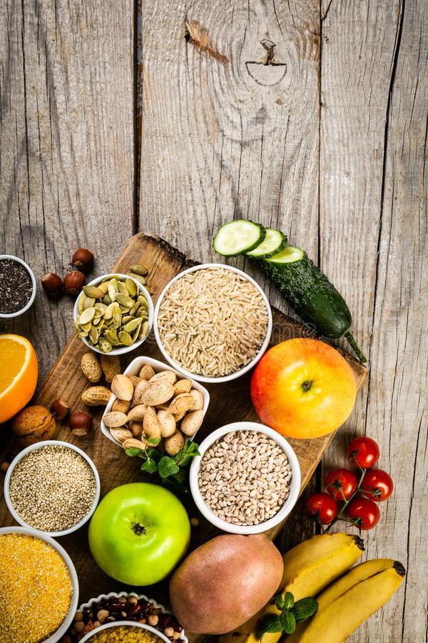 Selection of good carbohydrates sources. Healthy vegan diet. Selection of good carbohydrates sources - vegetables, fruits, grains, legumes, nuts and seeds stock image