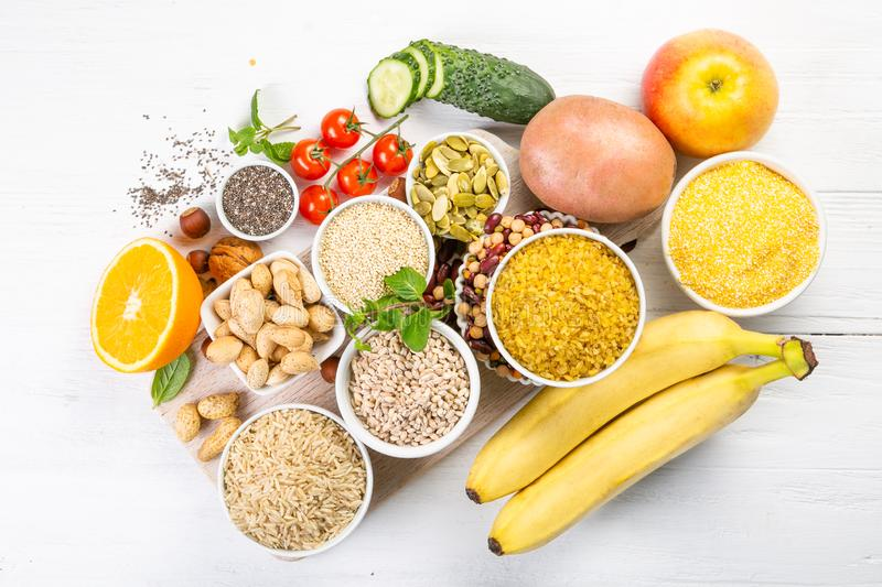 Selection of good carbohydrates sources. Healthy vegan diet. Selection of good carbohydrates sources - vegetables, fruits, grains, legumes, nuts and seeds royalty free stock photos