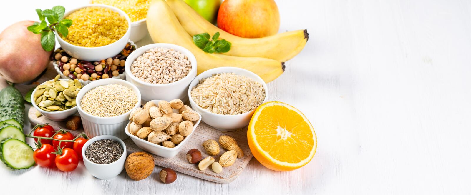 Selection of good carbohydrates sources. Healthy vegan diet. Selection of good carbohydrates sources - vegetables, fruits, grains, legumes, nuts and seeds royalty free stock image