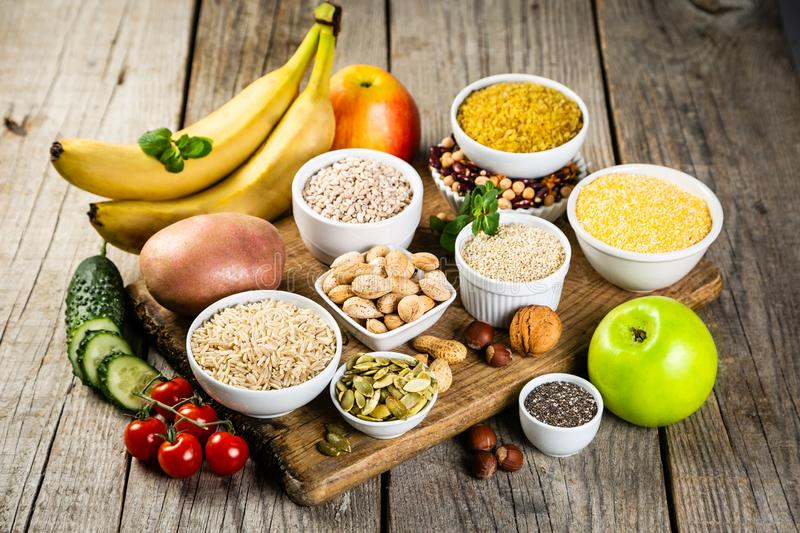 Selection of good carbohydrates sources. Healthy vegan diet. Selection of good carbohydrates sources - vegetables, fruits, grains, legumes, nuts and seeds stock photography