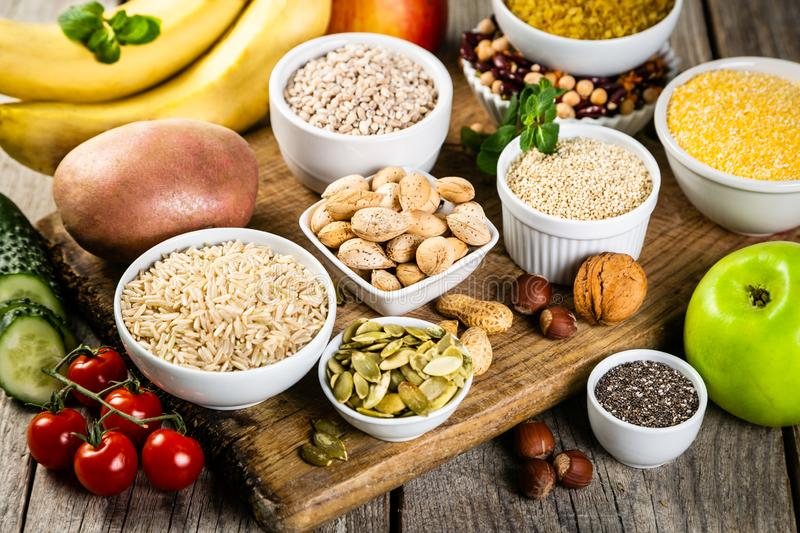 Selection of good carbohydrates sources. Healthy vegan diet. Selection of good carbohydrates sources - vegetables, fruits, grains, legumes, nuts and seeds royalty free stock photography