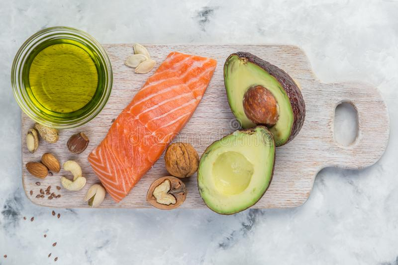 Selection of good fat sources - healthy eating concept. Ketogenic diet concept. Copy space stock photos