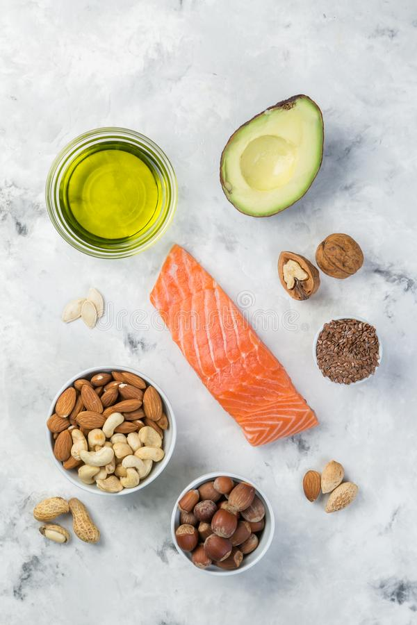Selection of good fat sources - healthy eating concept. Ketogenic diet concept. Copy space royalty free stock images