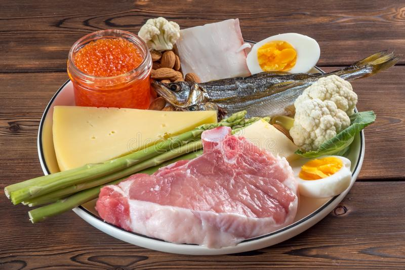 Selection of good fat sources of ketogenic diet products on a wooden background. Selection of good fat sources - healthy eating concept. Ketogenic diet concept royalty free stock images