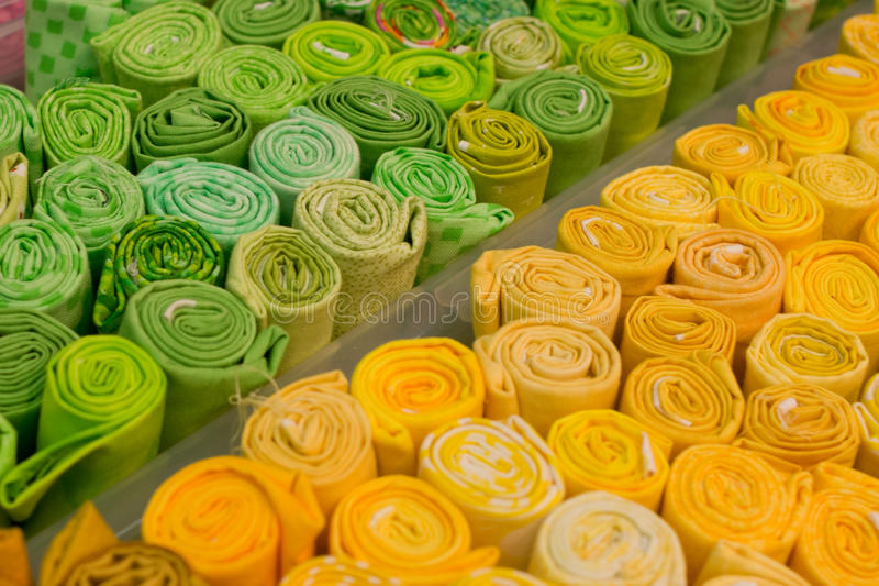 Download Selection Of Green And Yellow Pieces Of Clothes Stock Photo - Image of artist, reason: 23524230