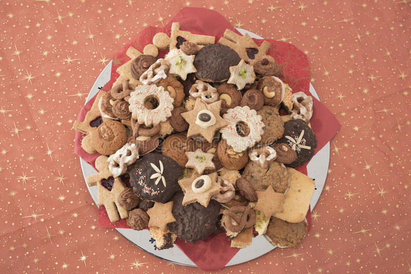 Selection of handmade Christmas cookies, textile background with stock photography