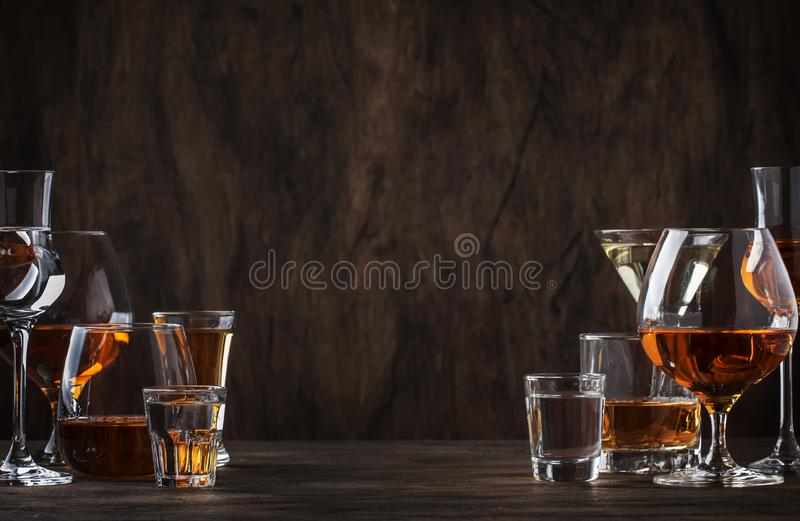 Selection of hard strong alcoholic drinks in big glasses and small shot glass in assortent: vodka, cognac, tequila, brandy and. Selection of hard strong royalty free stock photo