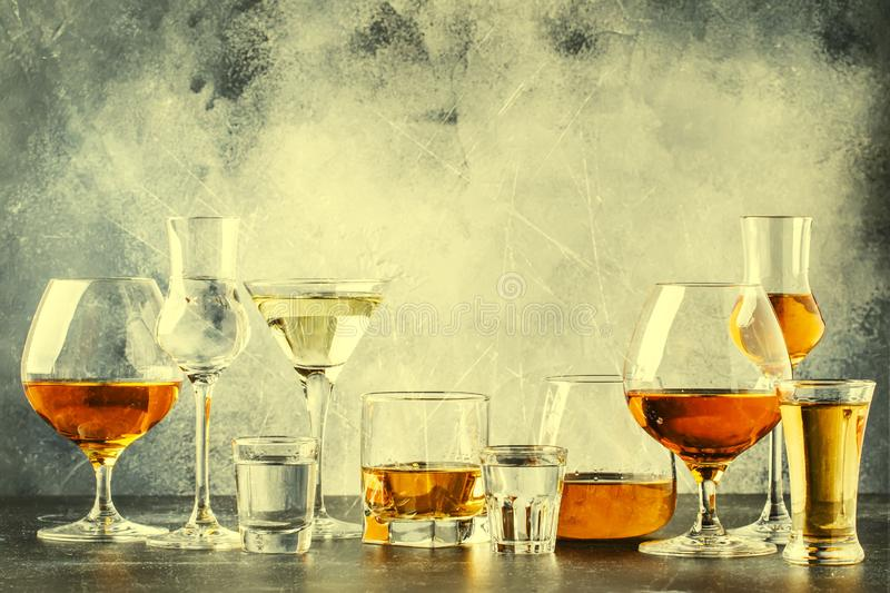Selection of hard strong alcoholic drinks in big glasses and small shot glass in assortent: vodka, cognac, tequila, brandy and. Whiskey, grappa, liqueur stock photo