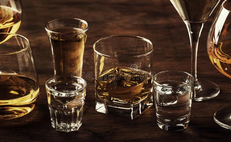 Selection of hard strong alcoholic drinks in big glasses and small shot glass in assortent: vodka, cognac, tequila, brandy and. Whiskey, grappa, liqueur stock image