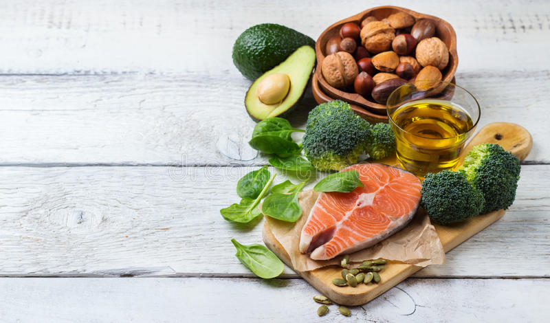 Selection of healthy fat sources food, life concept. Selection of healthy fat sources food, salmon fish avocado olive oil pumpkin seeds nuts broccoli green stock images