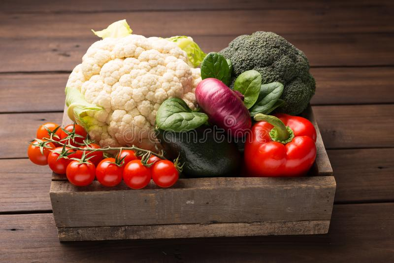 Selection of healthy food for heart, life concept. Vegetables in wooden box. royalty free stock photo