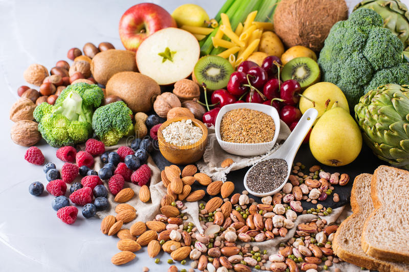 Selection of healthy rich fiber sources vegan food for cooking. Healthy balanced dieting concept. Selection of rich fiber sources vegan food. Vegetables fruit royalty free stock images