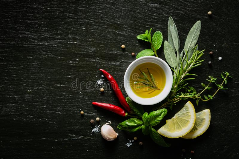 Selection of herbs and spices on black background stock images