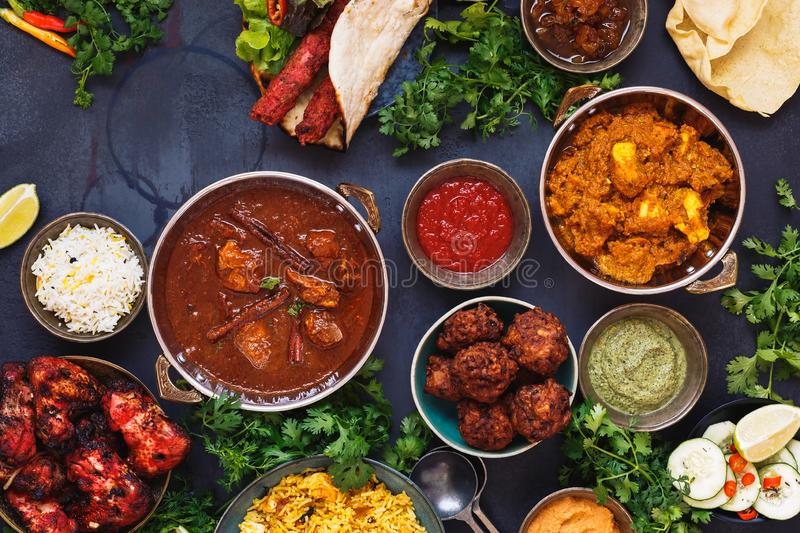Selection of Indian food with various bowls of food stock photo