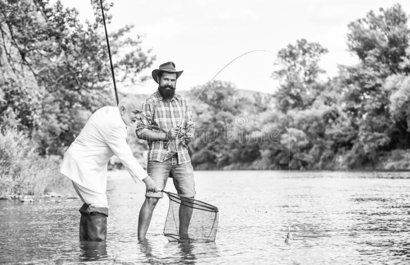 Selection of jobs. hobby of businessman. retirement fishery. happy fishermen. Good profit. friends men with fishing rod. And net. Fly fishing adventures stock image
