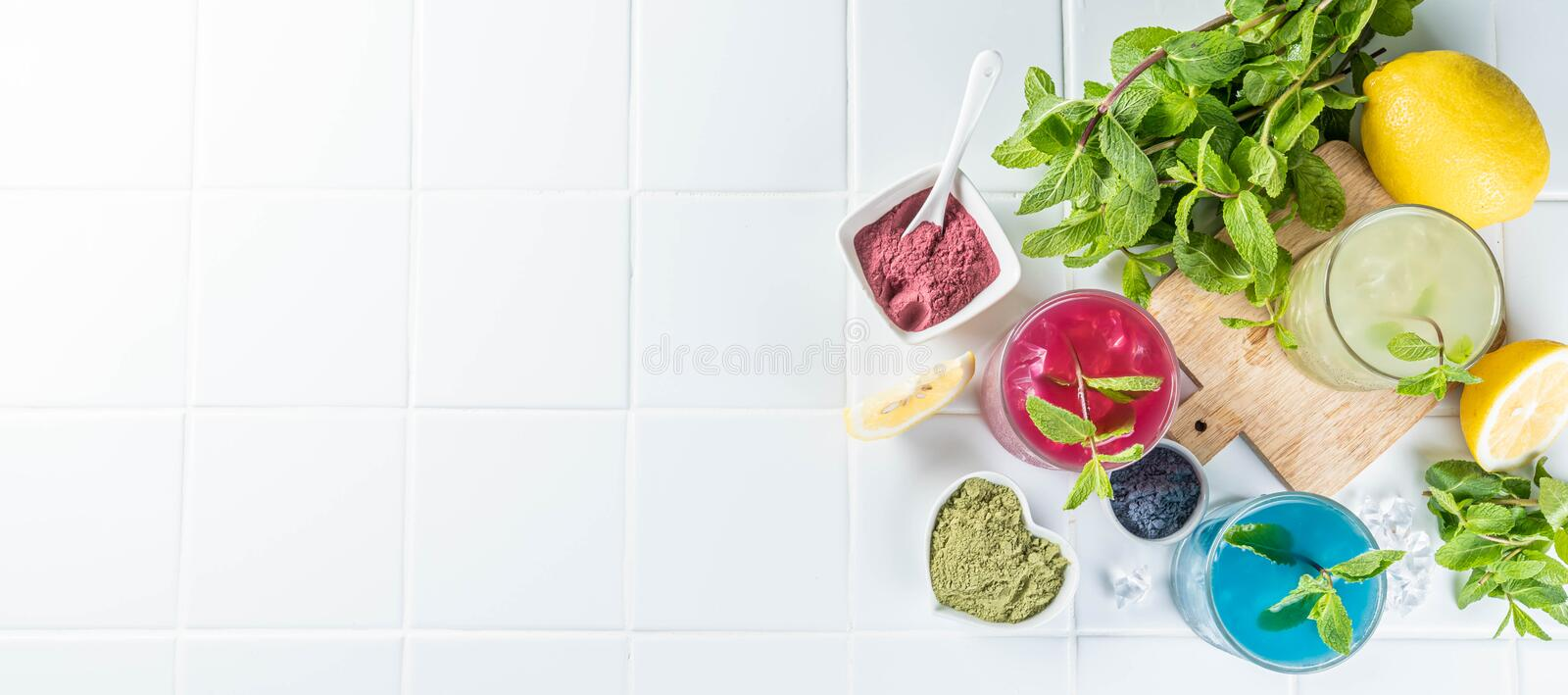 Selection of matcha lemonades - green, blue, red on white background royalty free stock image