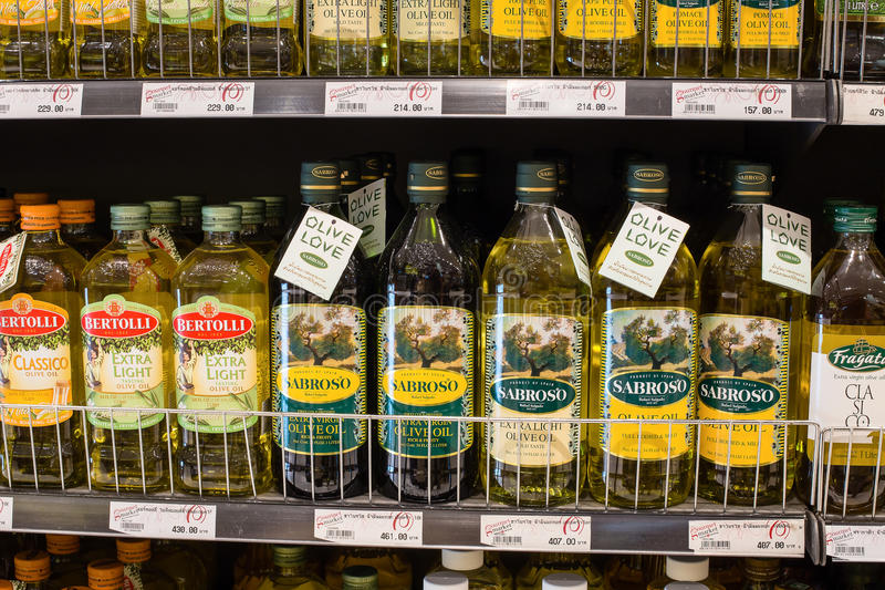 Selection of olive oil on the shelves in a supermarket Siam Paragon in Bangkok. royalty free stock image