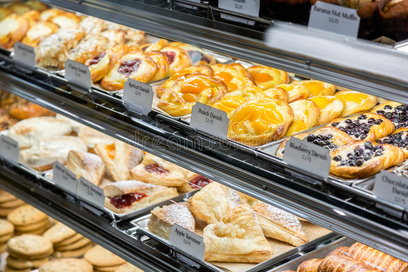 A selection of Pastries for sale. A choice of pastries for sale at a local grocery store royalty free stock photo