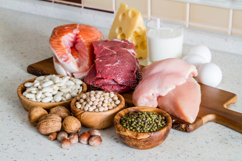 Selection of protein sources in kitchen background stock photography