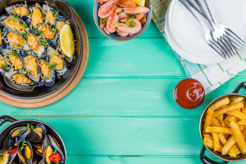 Selection of seafood meal on wood background royalty free stock photography