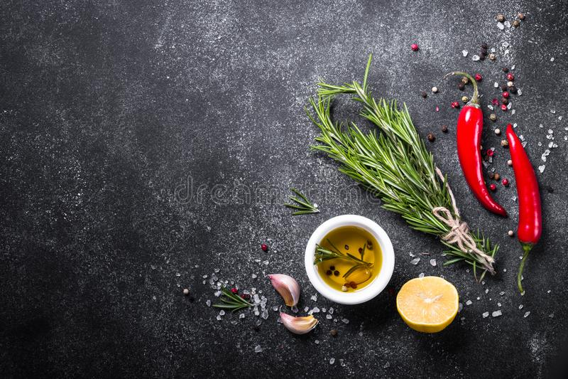 Selection of spices and herbs on dark. stock image