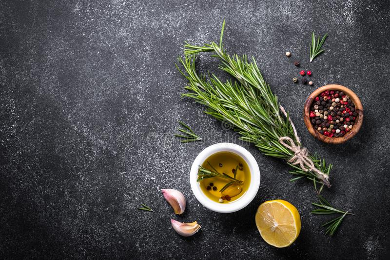 Selection of spices and herbs on dark. royalty free stock photography