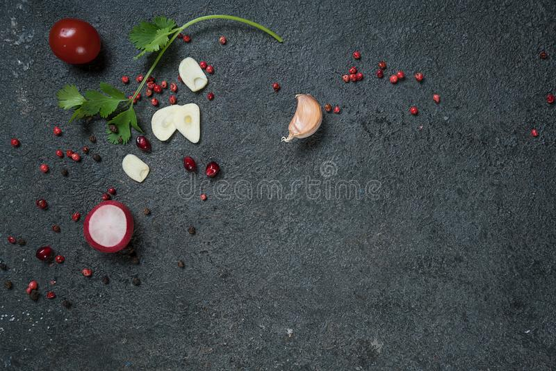 Selection of spices herbs and greens. Ingredients for cooking. Food background on black slate table. stock image